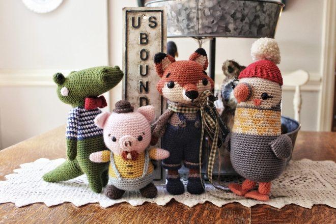 Amigurumi alligator, pig, fox, and puffin.