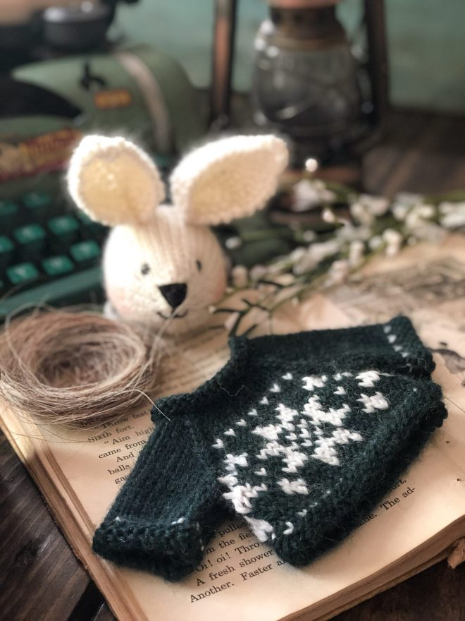 Fuzzy bunny head and Nordic sweater in forest green and white.