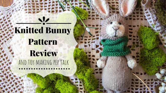 Knitted bunny with green cowl.