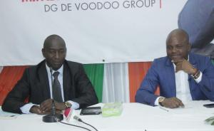 Traoré Moussa, président de l'Unjci à gauche et Fabrice Sawegnon, DG de Woodoo Group à droite. Ph.C.B