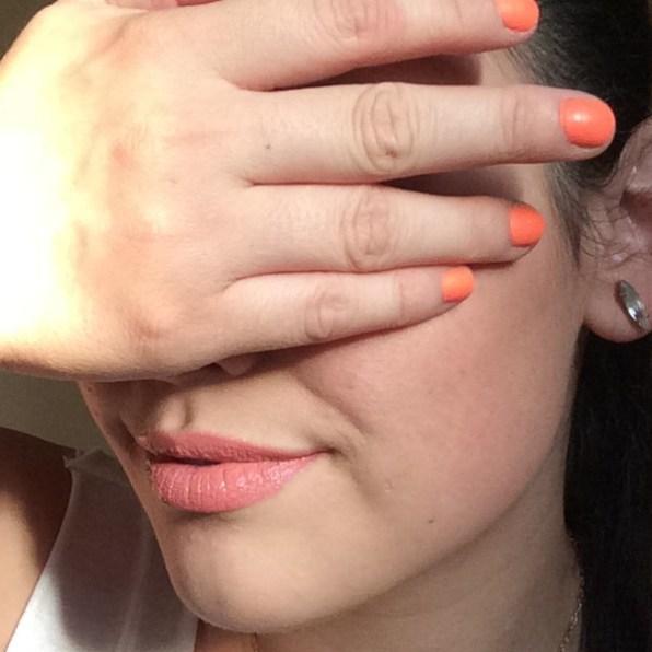 Pink lips and orange nails