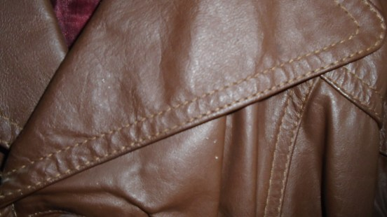 Brown leather jacket detail