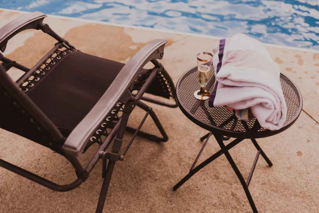 lounging zone with champagne in poolside