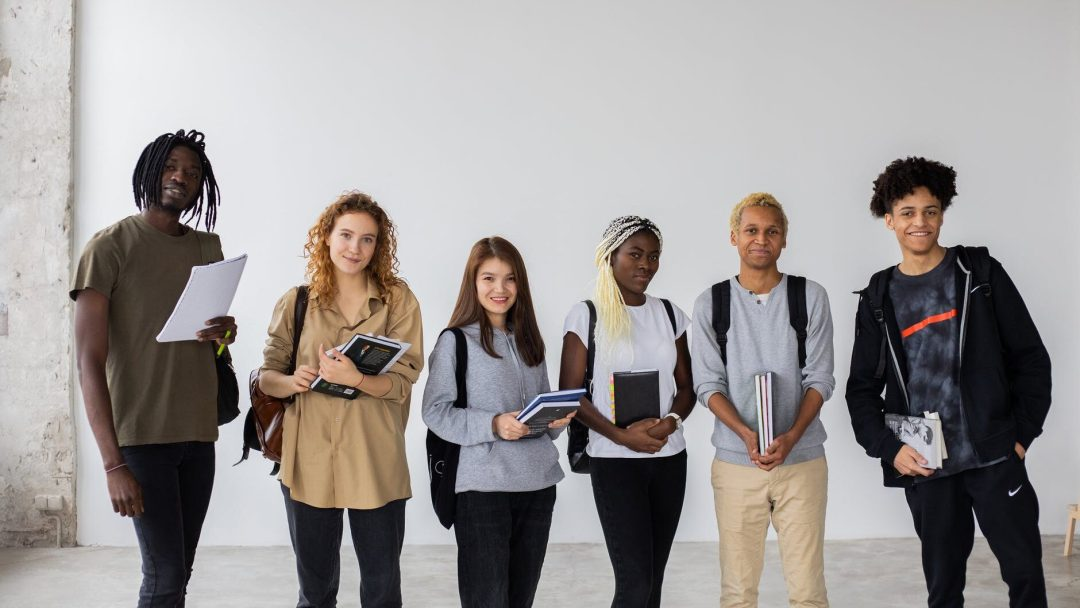 group of multiethnic students with books and documents
