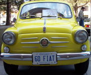 A 1960 Fiat yellow something.
