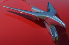 A cool hood ornament on a Chevy.