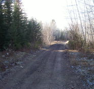 Along the abandoned rail line (now a atv/snowmobile track).