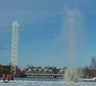 Breaking up the ice with explosives to prevent flooding is FUN to watch!