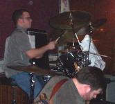 Carlos on drums.