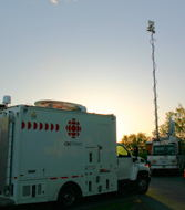 The CBC TV truck and the CJOH truck with the sun setting.