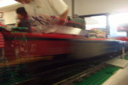 The lego trains were <B>fast</B>.  This one is moving so fast you can see thought it.