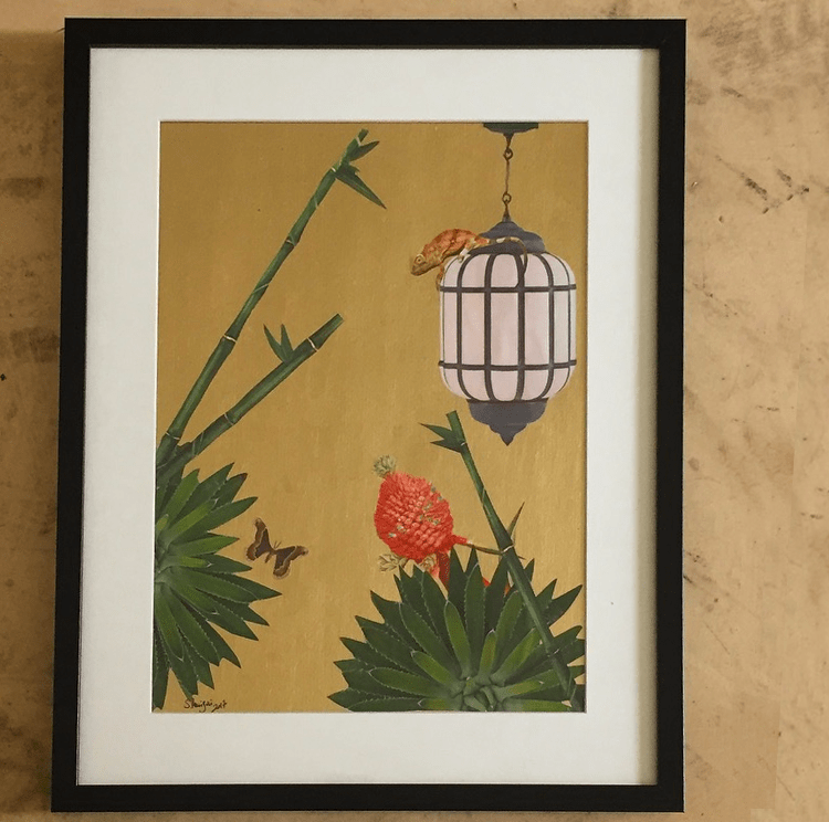 Paper collage with a chameleon on a lantern waiting a butterfly flying to him. Gold acrylic back, 2017