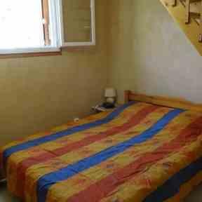 chambre appartement de vacances côté jardin