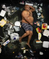 James surrounded by seven days of his own rubbish in Pasadena, California. (Photo by Gregg Segal/Barcroft Media)