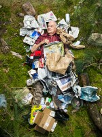 Milt surrounded by seven days of his own rubbish in Pasadena, California. (Photo by Gregg Segal/Barcroft Media)