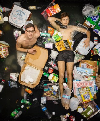 Till and Nicholas surrounded by seven days of their own rubbish in Pasadena, California. (Photo by Gregg Segal/Barcroft Media)