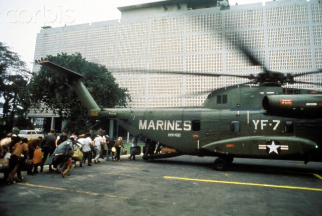 Boarding helicopter inside US Embassy , Fall of Saigon, Vietnam, 1975             m War, 1975