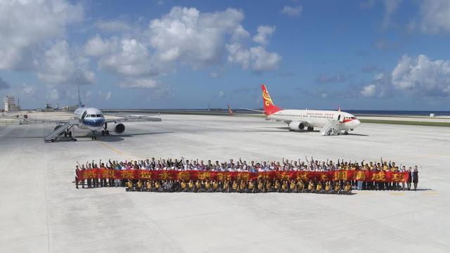 Equipages posant après l'atterrissage du vol civil de janvier 2016