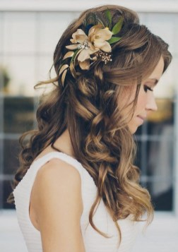 Wedding hair style long curl with flower accessory by Les Ciseaux St. Armands