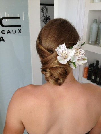 Wedding hair style up do with flower accessory by Les Ciseaux St. Armands