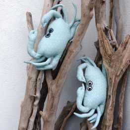Petit crabe repose-tête vert amande
