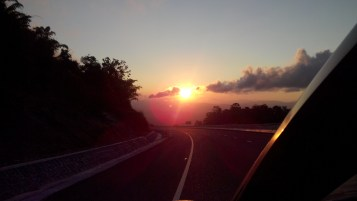 Watching the sunrise on the open highway