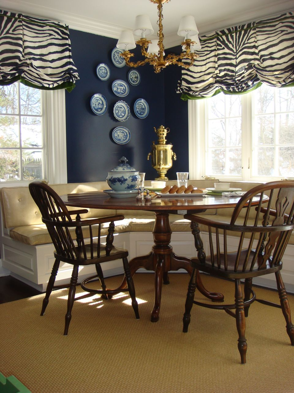 I did this for a client with little ones...the banquette is wipeable snake skin! lesliemaydesigns.com