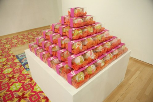 Yarmulke Tower , 4' x 4' x 4', mixed media: fabric, plastic, screenprint on paper, tissue paper, wood, paint, audio and speakers, 2011. *Yarmulkes were available as a free keepsake