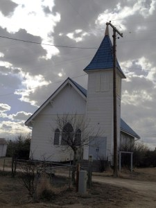 Blue roofed church in Sweetgrass, Montana