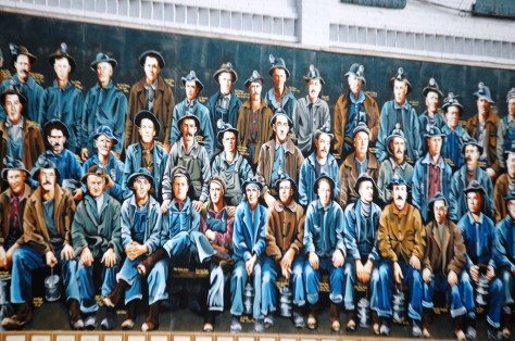 A portion of a mural honoring 100s of iron workers in downtown Ironwood, MI