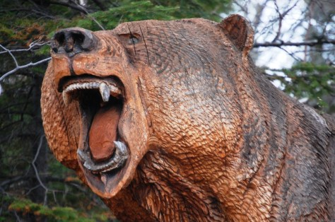 Giant wood carved grizzly head at Grizz Works in Maple, WI