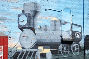 Train mural in Glasgow Montana on the side of a building