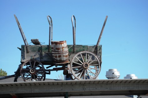Old covered wagon on a building in Choteau, Montana