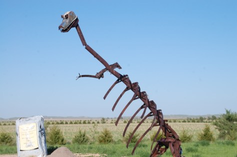 A 15 foot dinosaur overlooks Carhenge