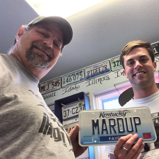 Donating MARDUP License Plate to Beau Neville at Carhenge