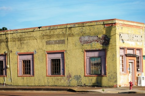 Colorful yellow abandoned building in Shelby, MS