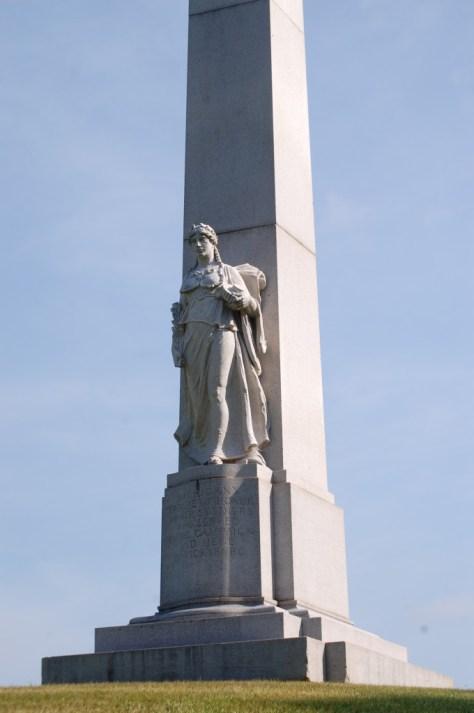 Obelisk with sculpture