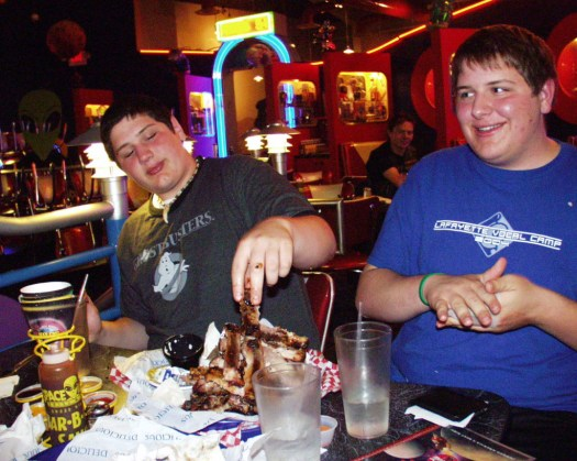 Finishing off a pile of ribs at Space Aliens back in 2005