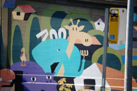 A Mural under a bridge. It was created as a Paint By Number and then many Seattle residents added the paint
