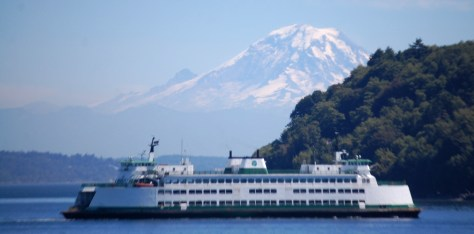 A ferry passes by us in the sound with Mt. Rainier in the backround