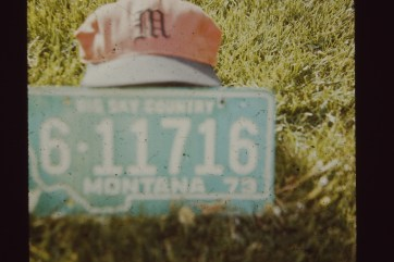 Took this photo of our Montana license plate with a Murray High School (UT) hat in 1976