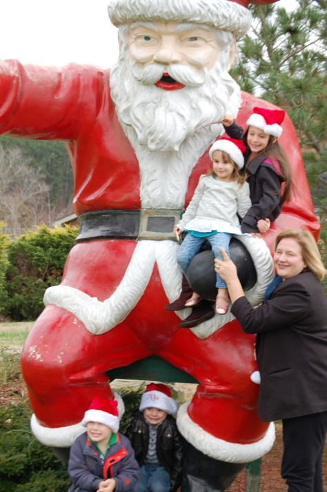 "Julianne and Grandkidz cuddling with the ""Angry Santa"""