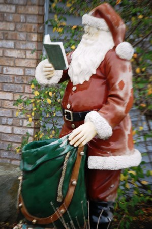 Another Santa Claus reading a book