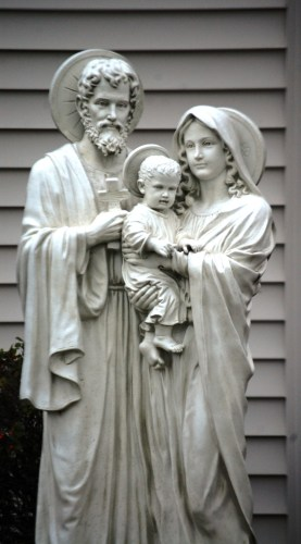 A statue of Joseph, Mary and Jesus in front of Saint Nicholas Catholic Church. Most Catholic churches just have a Mary...so this was unique