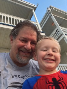 Outside the Normandie Inn with grandson Rockwell