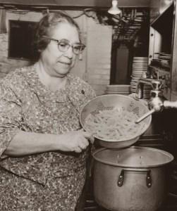 Mama Guarino making pasta in the kitchen