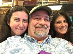 """With sister Nicole (R) and """"adopted sister"""" Michelle (L) who assists at the shop"""