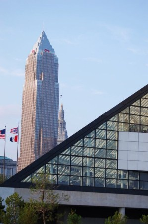 Buildings of Cleveland seen behind the glass pyramid of the Rock and Roll Hall of Fame
