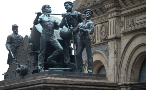 """Mortar Practice"" represents the Navy Group. In this sculpture, an officer and five men are loading a mortar, preparing to fire upon enemy entrenchments."