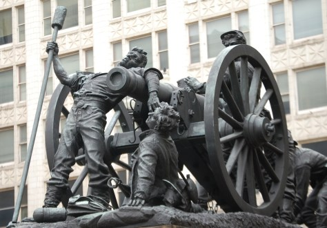 "One of four bronze statues that surround the monument. Called ""At Short Range"" it is a representation of the Artillery Group"